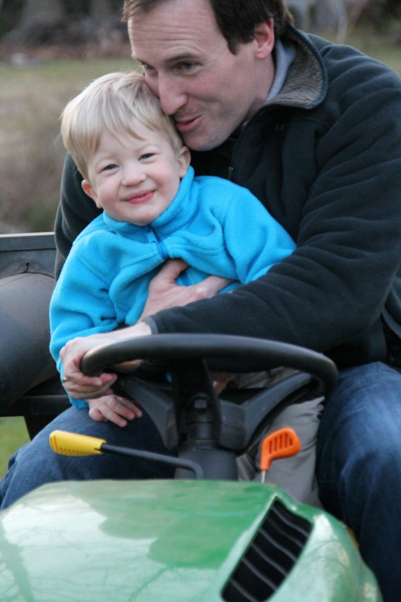 Case tickled on mower with Daddy